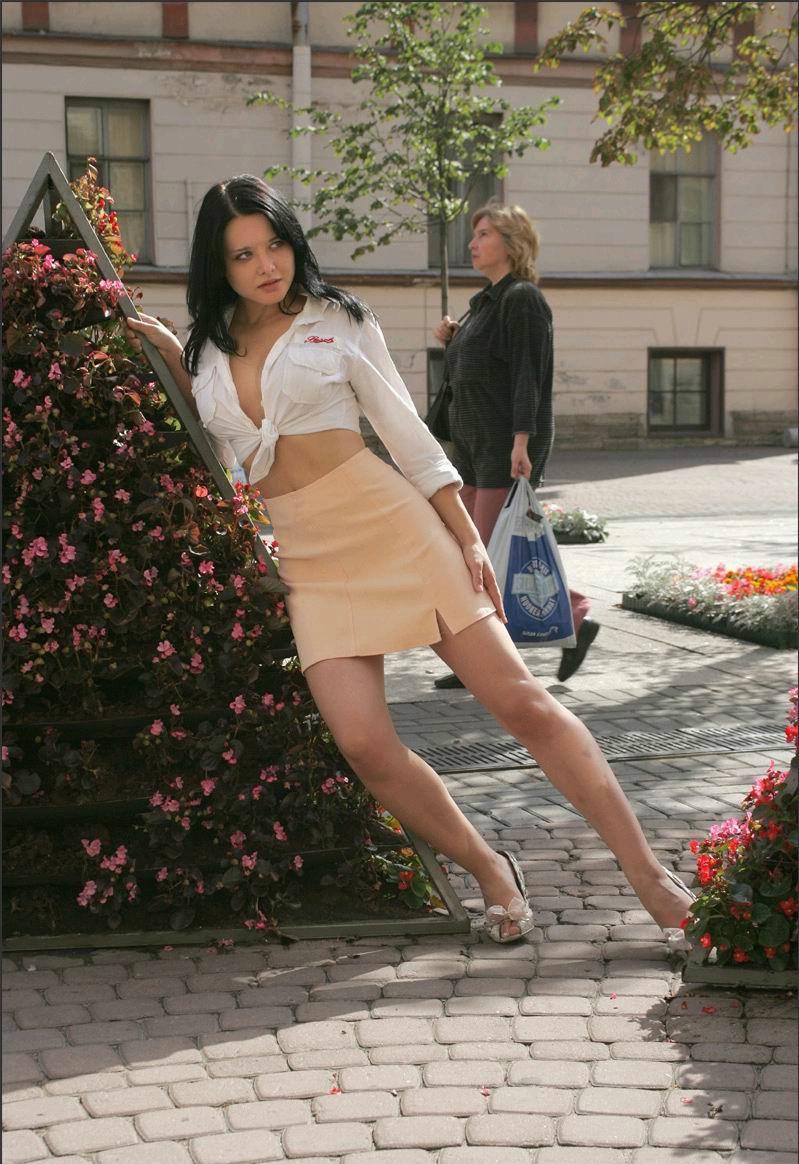 Brunette nude in public