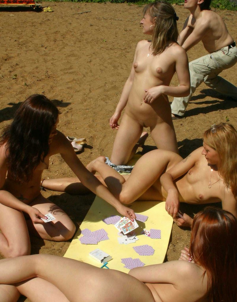Girls playing cards at the beach