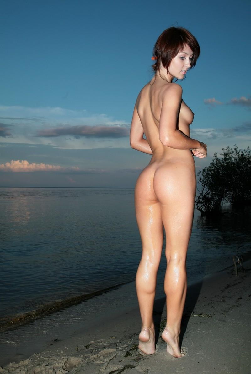 Girl posing by the lake