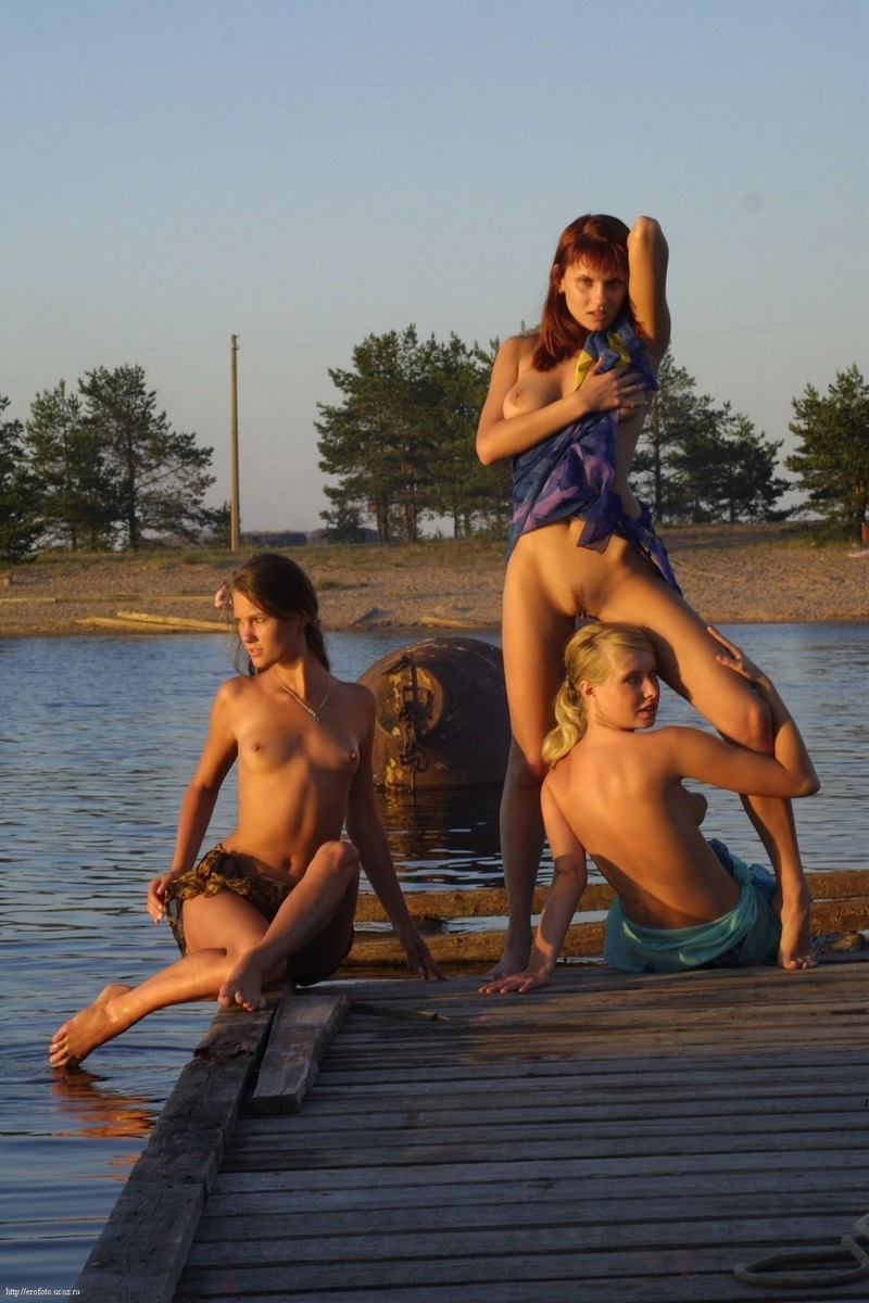 Three girls by the lake