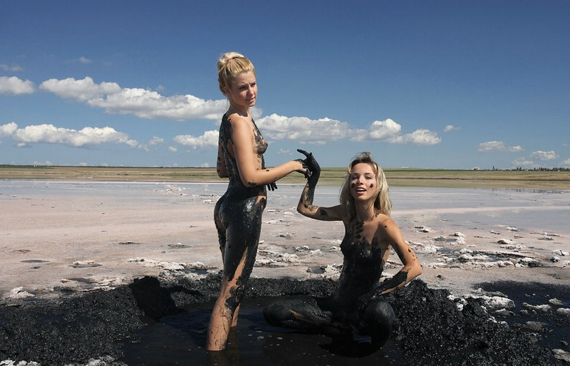 Girls playing in mud
