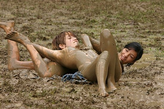 Girls having fun in mud