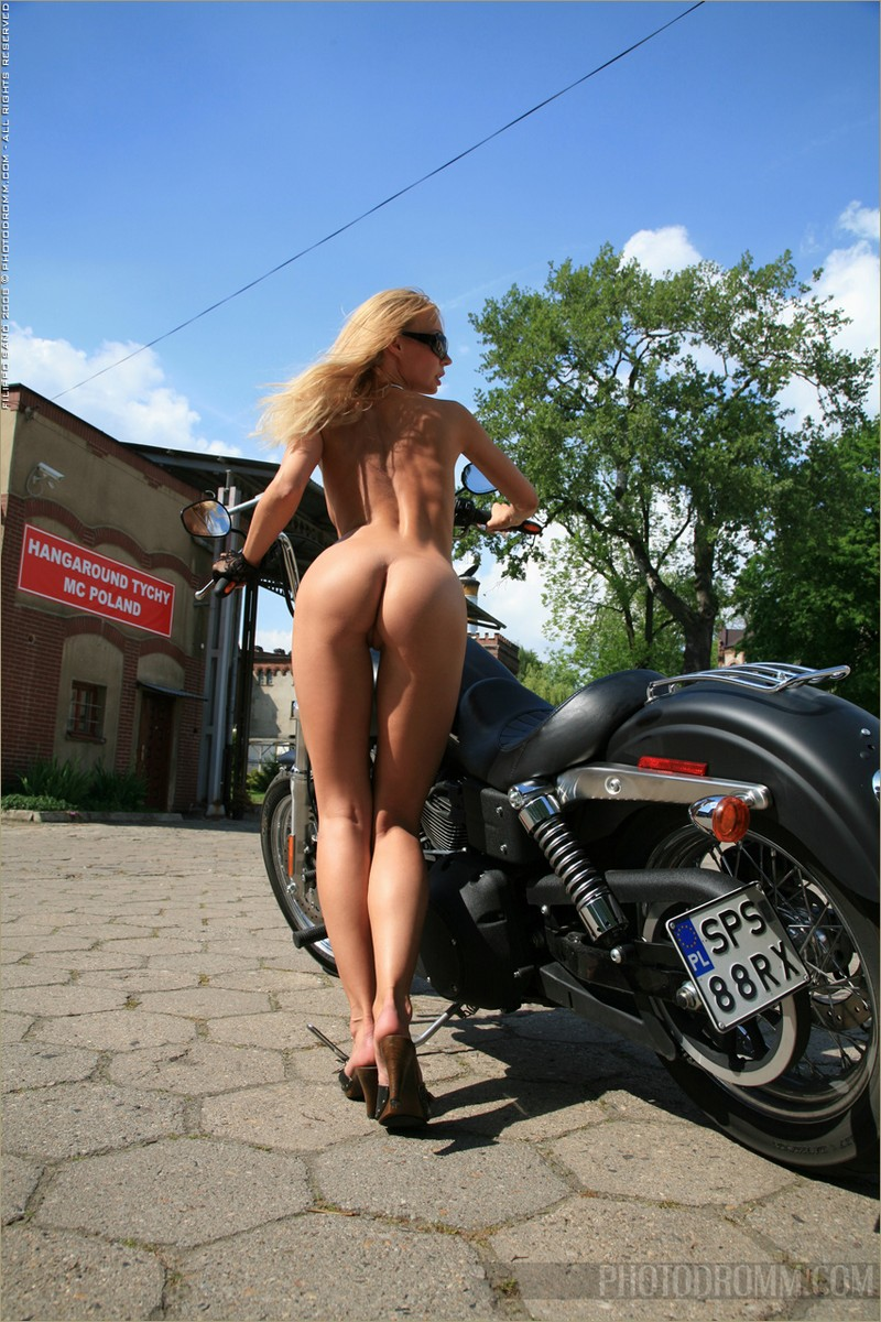 Motorcycle girl with naked boobs