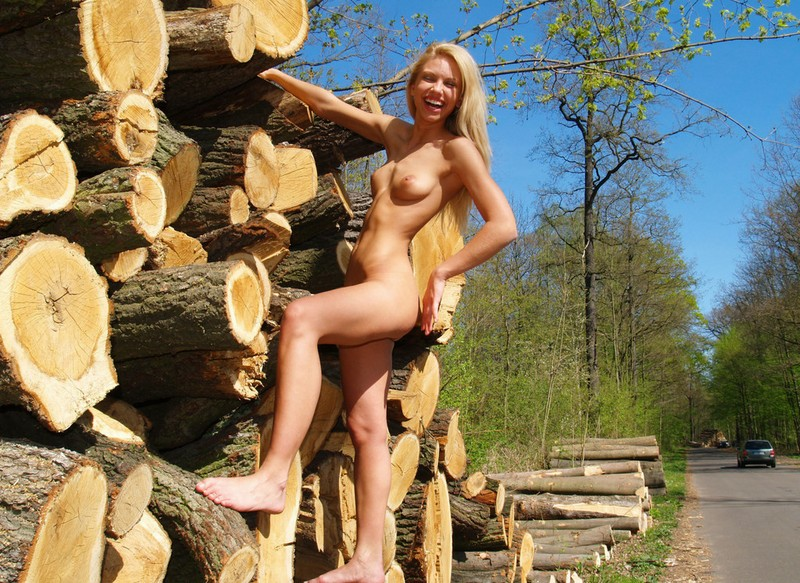 Blonde nude in woods