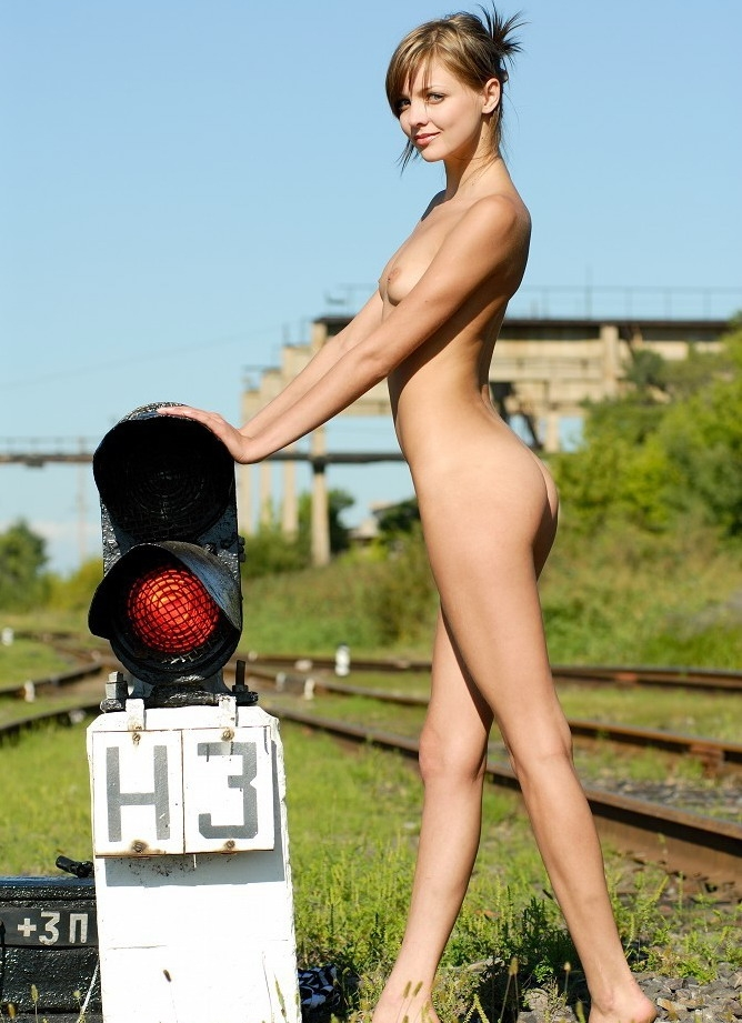 Girl on rail tracks