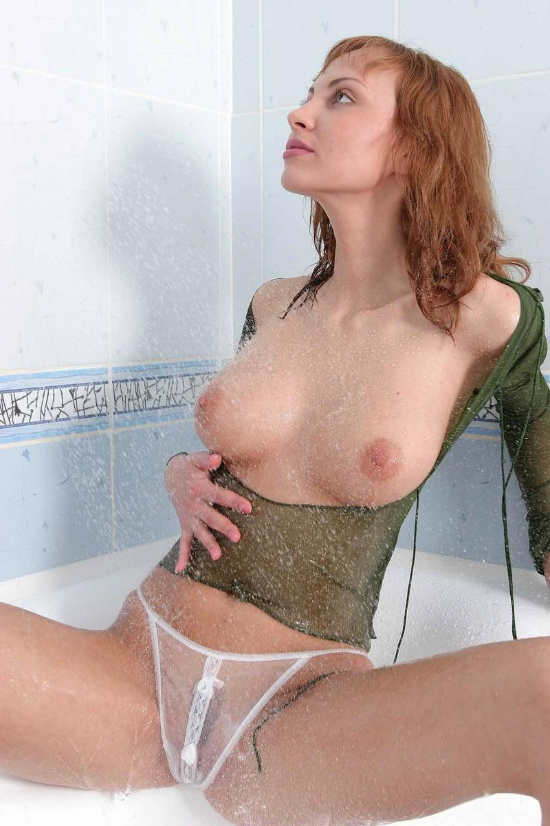 Wet redhead in bath