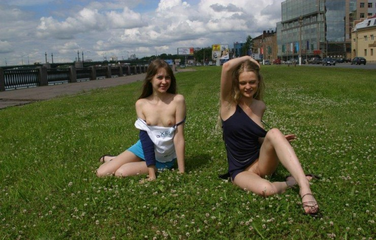 Two young girls naked on the street