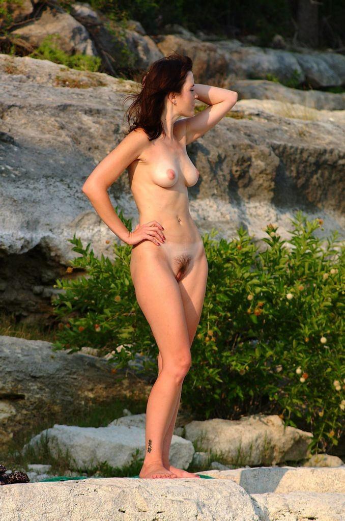 Woman undressing on the beach