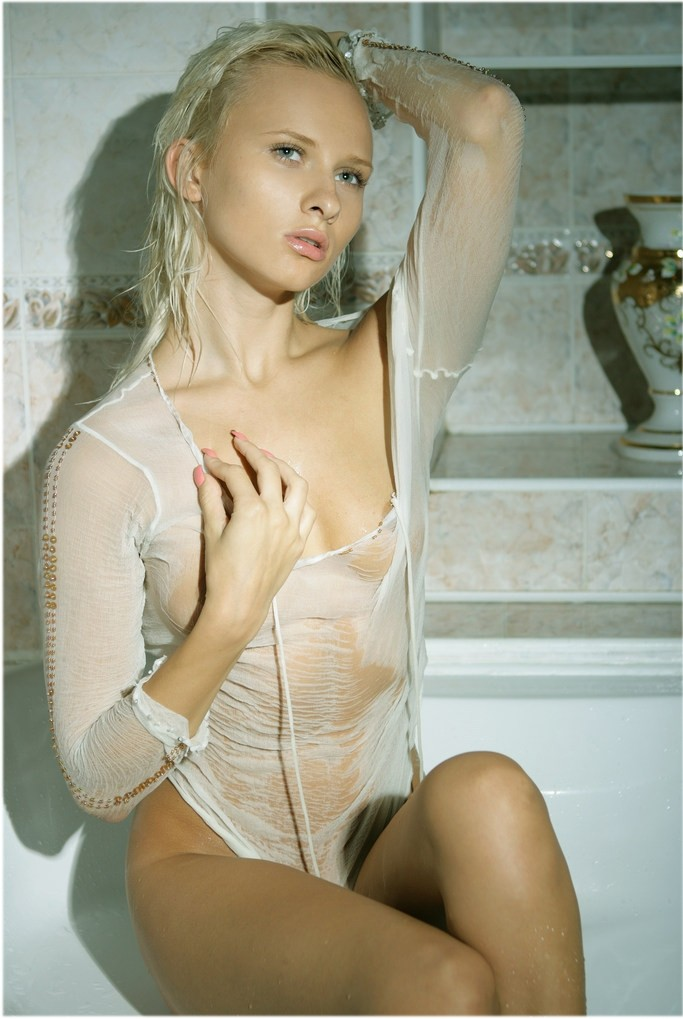 Wet blond in bathroom