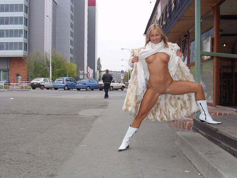 Blond girl taking a walk in fur coat