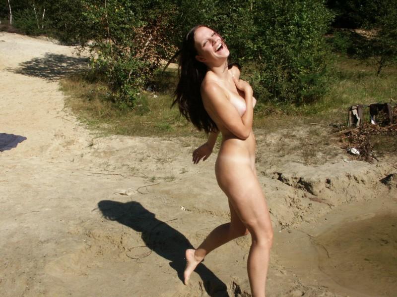 Cute girl gives handjob in public