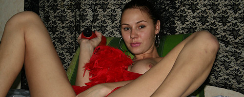 Amateur girl with red dildo