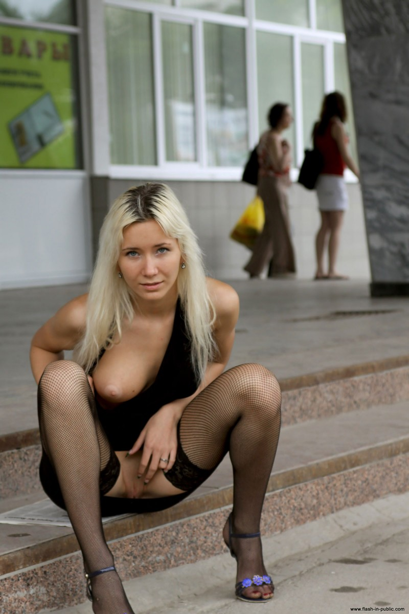 Nude girls flashing pussy in public