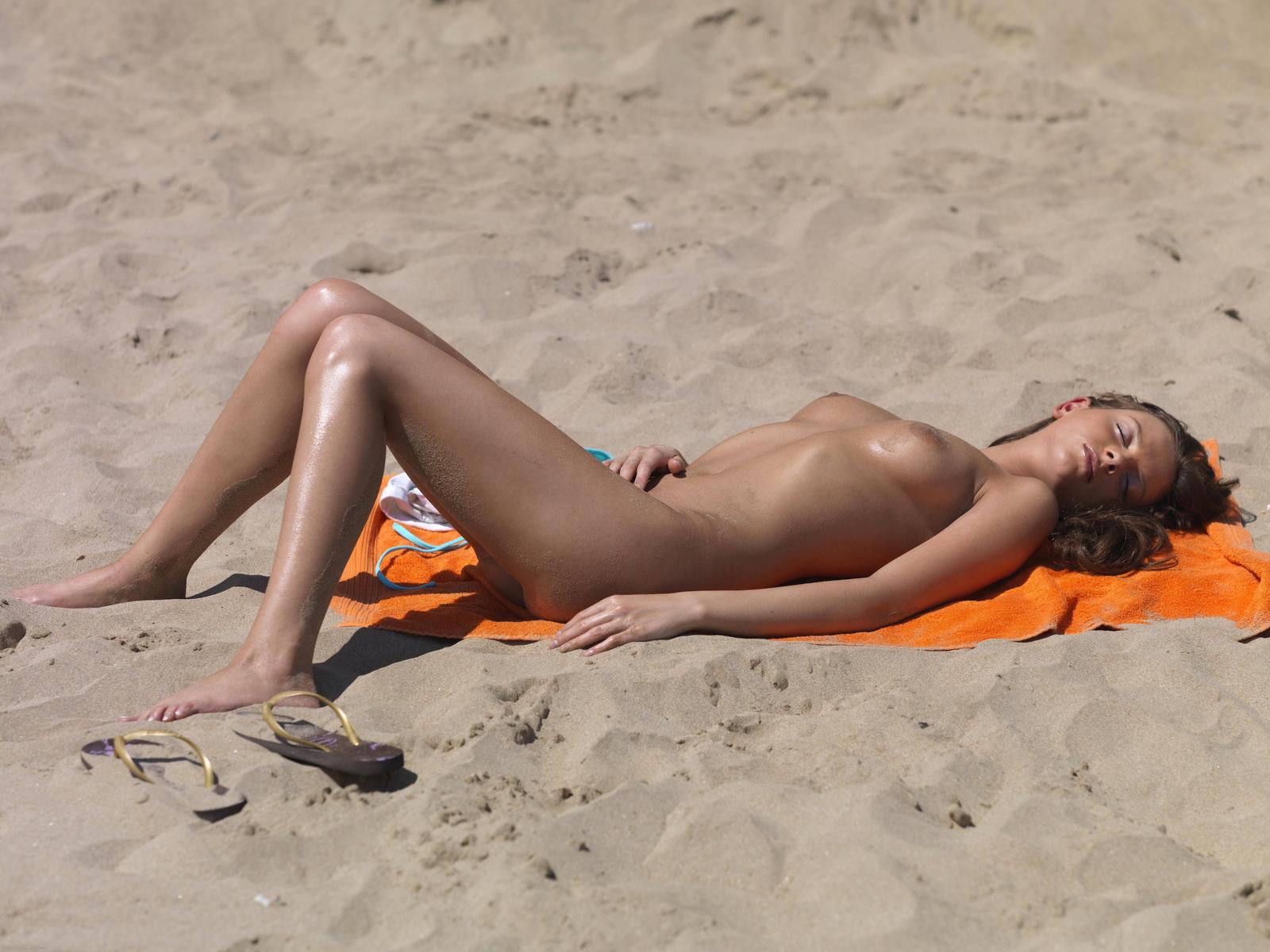 Beach naked sunbathing