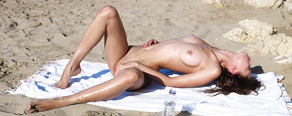 Anna Sbitnaya on the beach