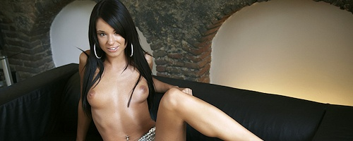 Ashley Bulgari on leather couch