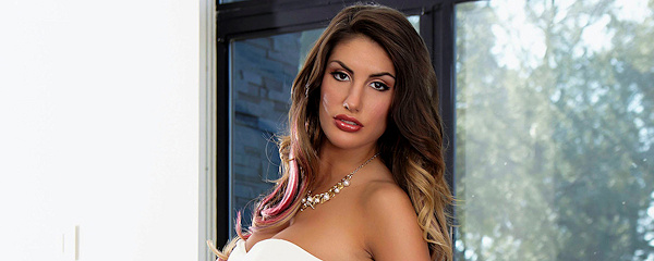 August Ames in white dress
