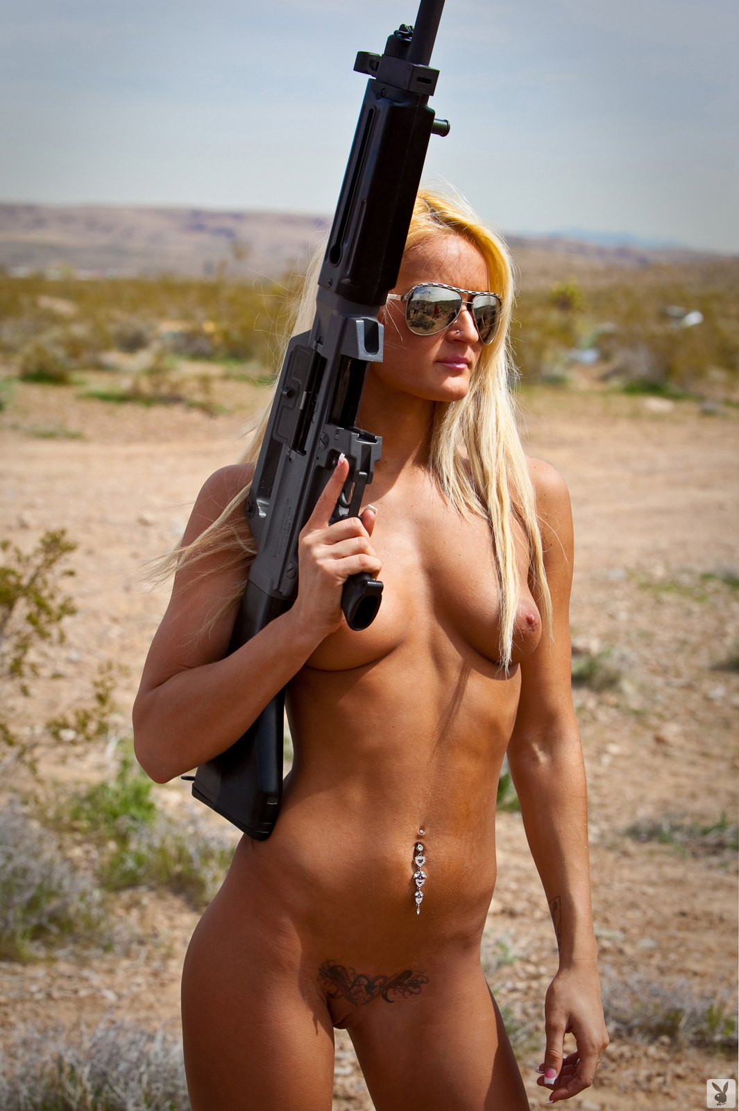 playboy-badass-nude-episode-01-guns-desert-04
