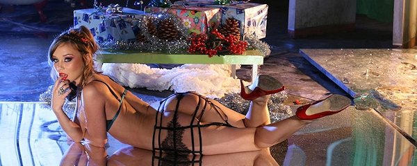 Capri Anderson under the Christmas tree