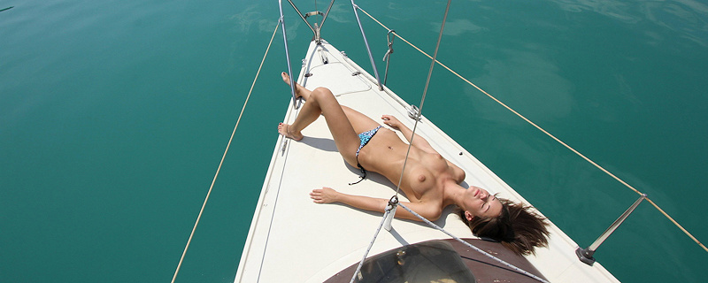 Caprice sunbathing on yacht