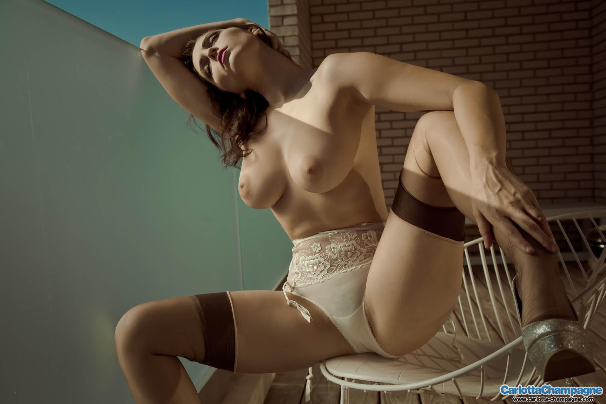 carlotta-champagne-tits-balcony-stockings-garters-nude-08