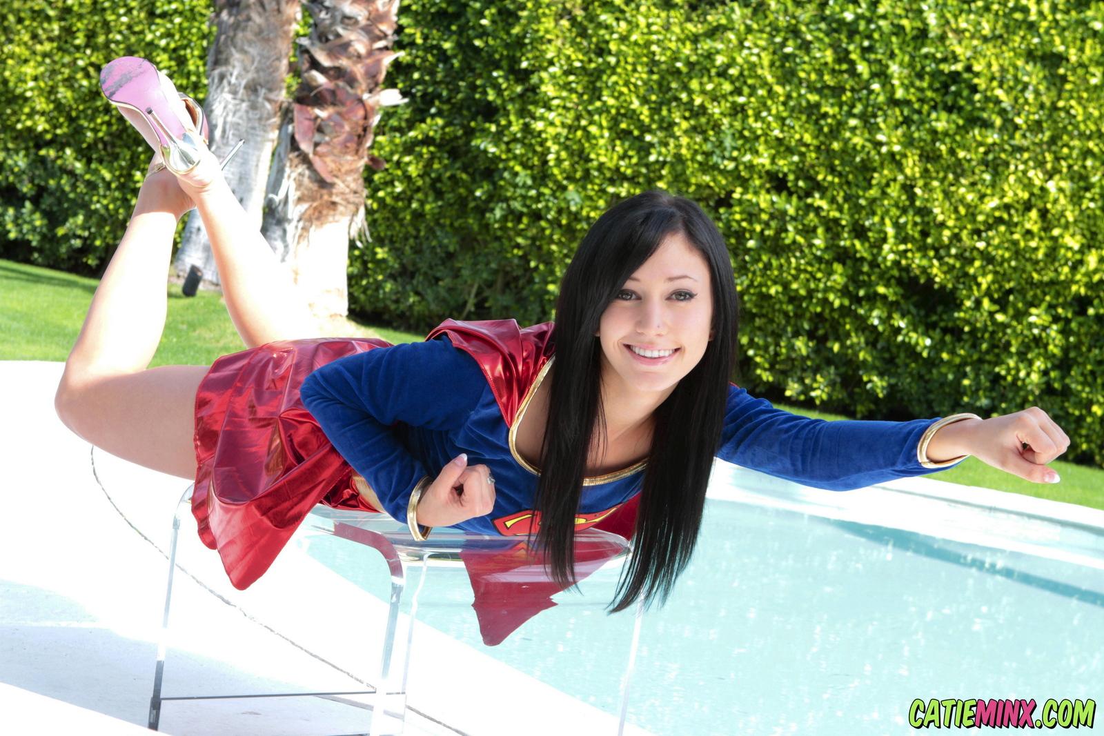 catie-minx-supergirl-costiume-poolside-young-brunette-nude-02