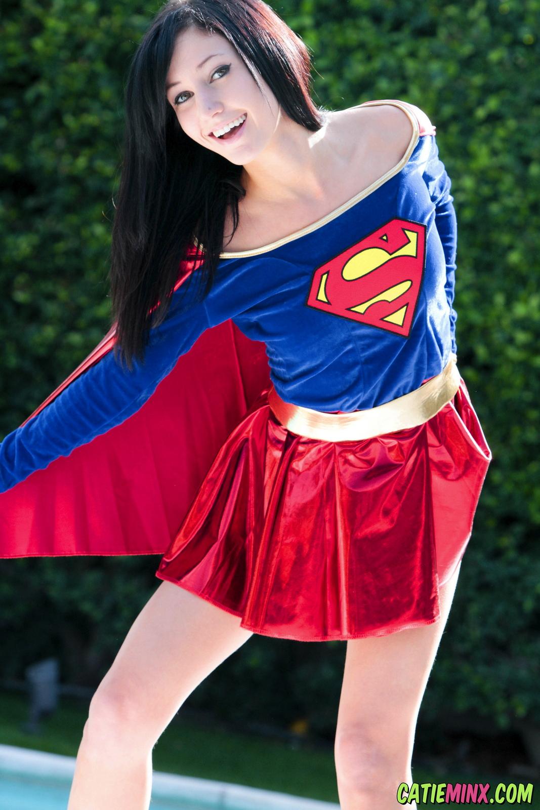 catie-minx-supergirl-costiume-poolside-young-brunette-nude-12