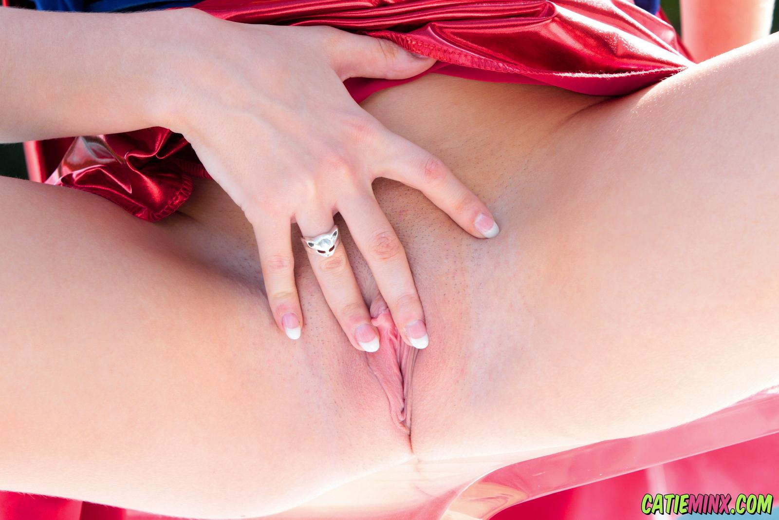 catie-minx-supergirl-costiume-poolside-young-brunette-nude-35