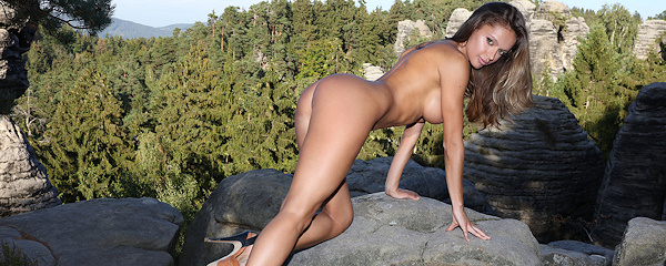 Dana Harem hiking on the rocks