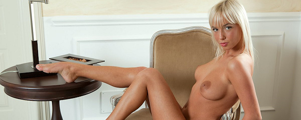 Emma nude on armchair