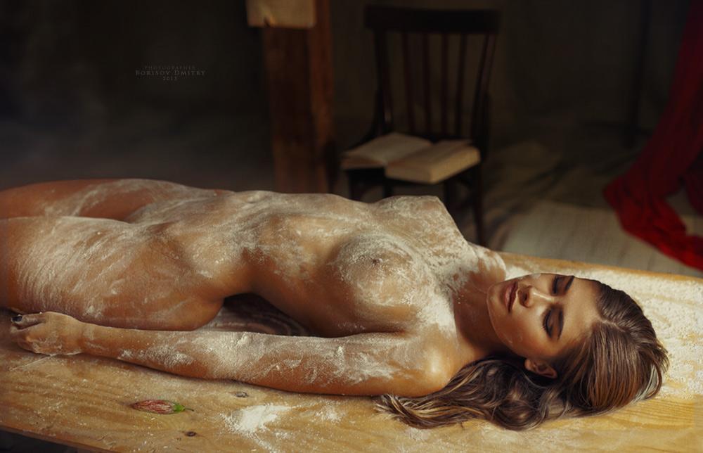 Naked girl covered in honey