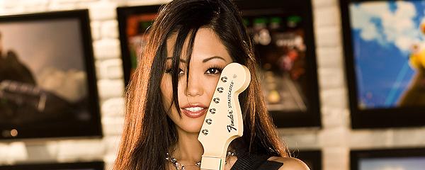 Grace Kim playing the guitar