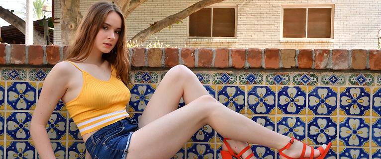 Hazel Moore – Red heels & shorts