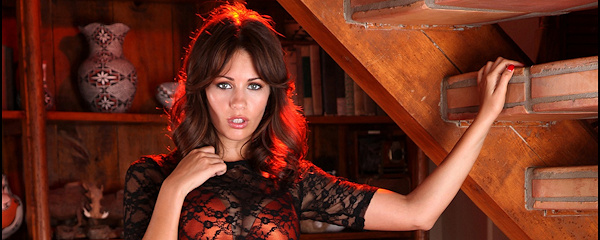 Holly Peers under the stairs