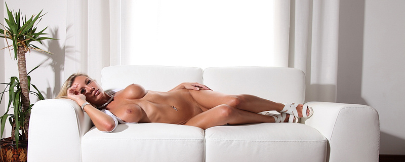 Janine Leech lying on the sofa