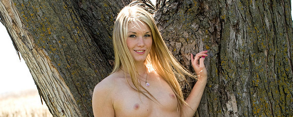 Jewel nude under the tree