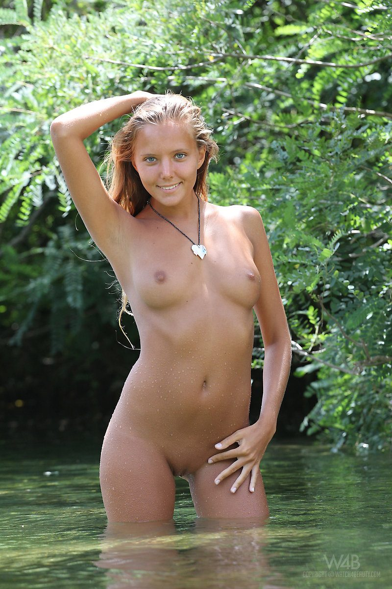 Young naked woman swimming
