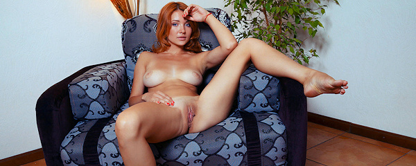 Kika nude on armchair
