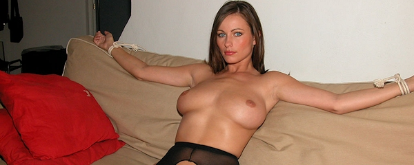 Kyla Cole tied up on sofa