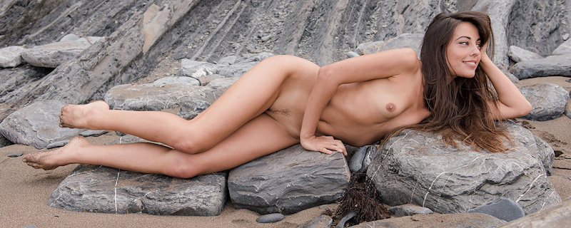 Lorena on rocky beach