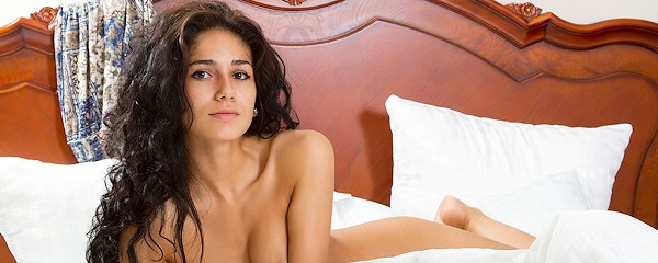 Malina naked in bed
