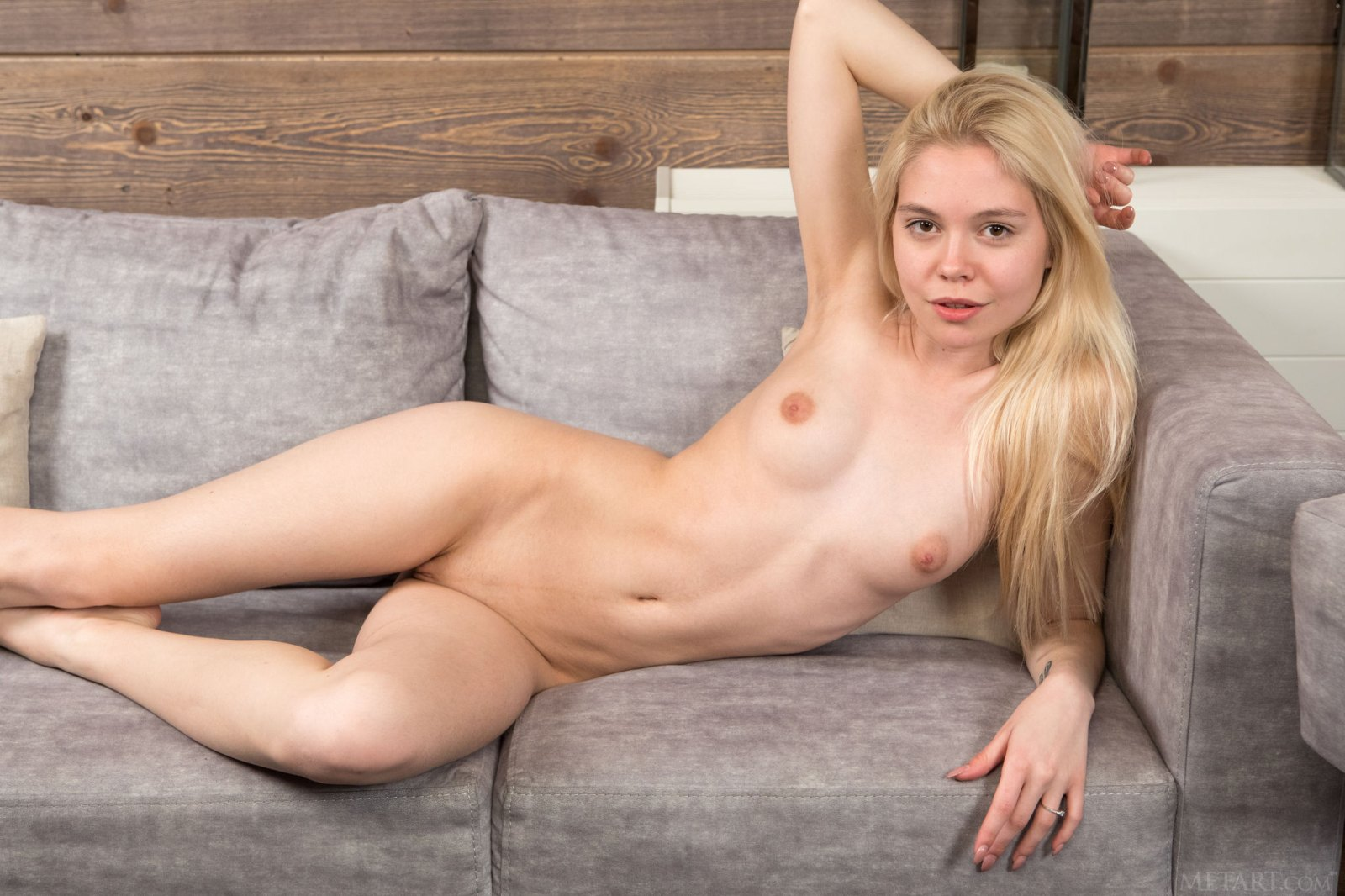 Young blonde nude with jersey