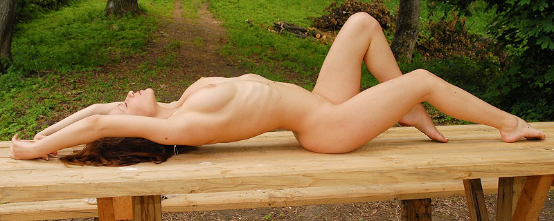 Marliece nude on picnic bench