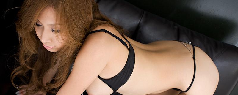Mayumi Sendoh on leather sofa