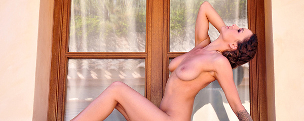 Mica Martinez nude on windowsill