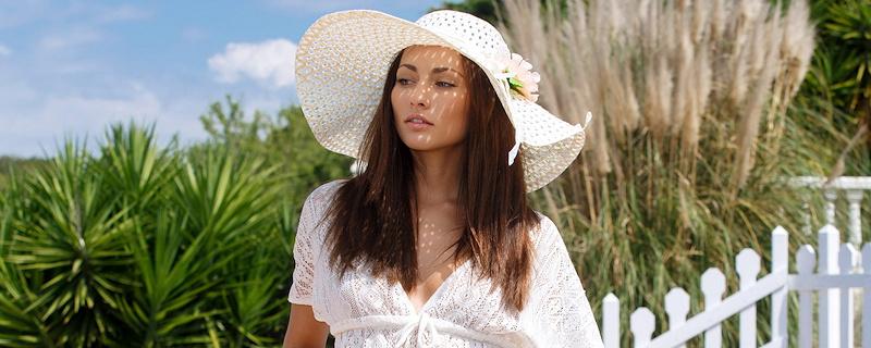 Michaela Isizzu in white sun hat
