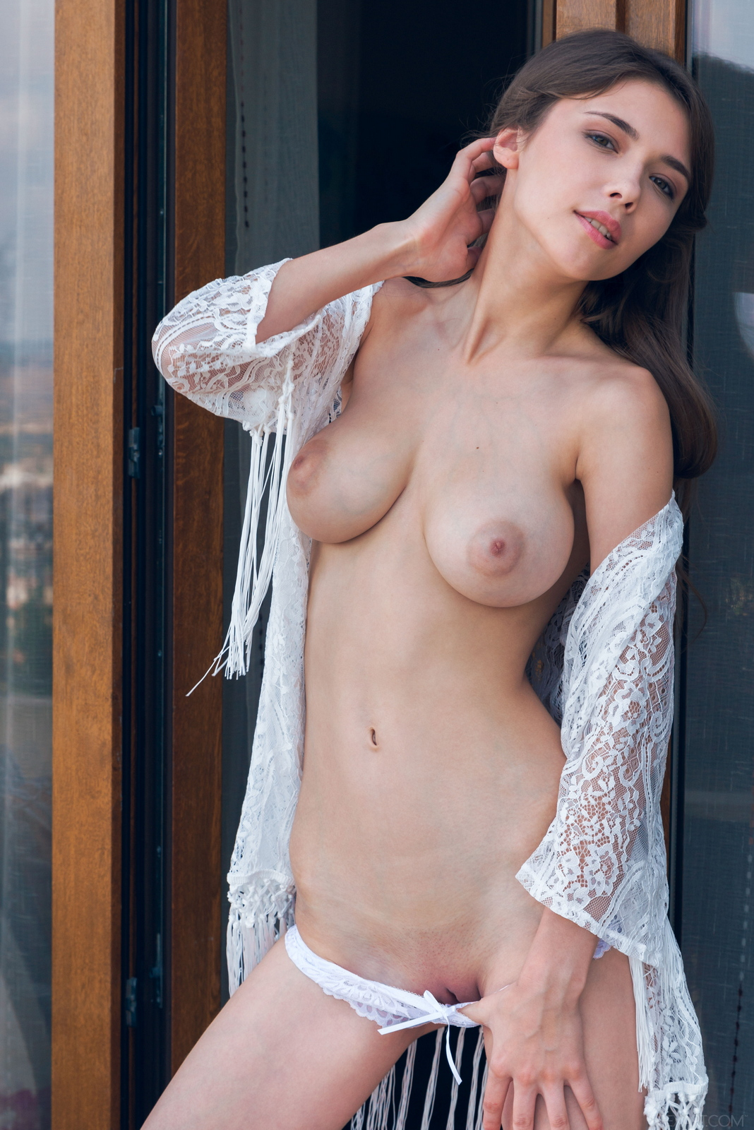mila-azul-balcony-naked-boobs-slim-sexart-09