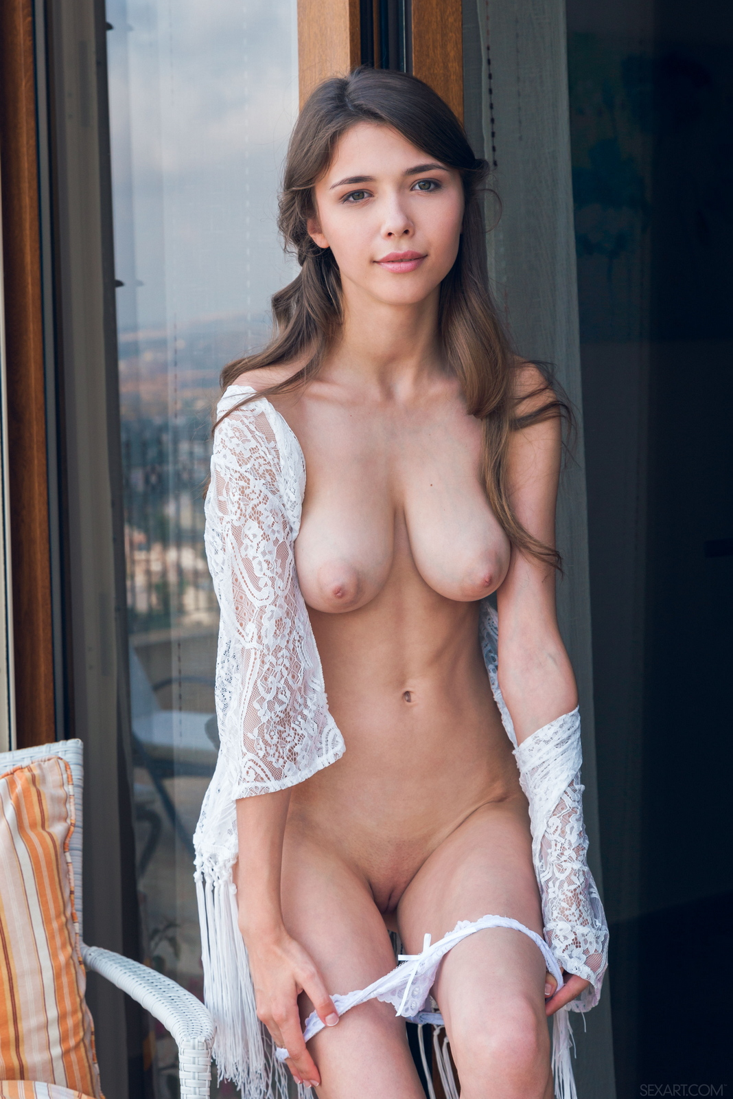 mila-azul-balcony-naked-boobs-slim-sexart-11