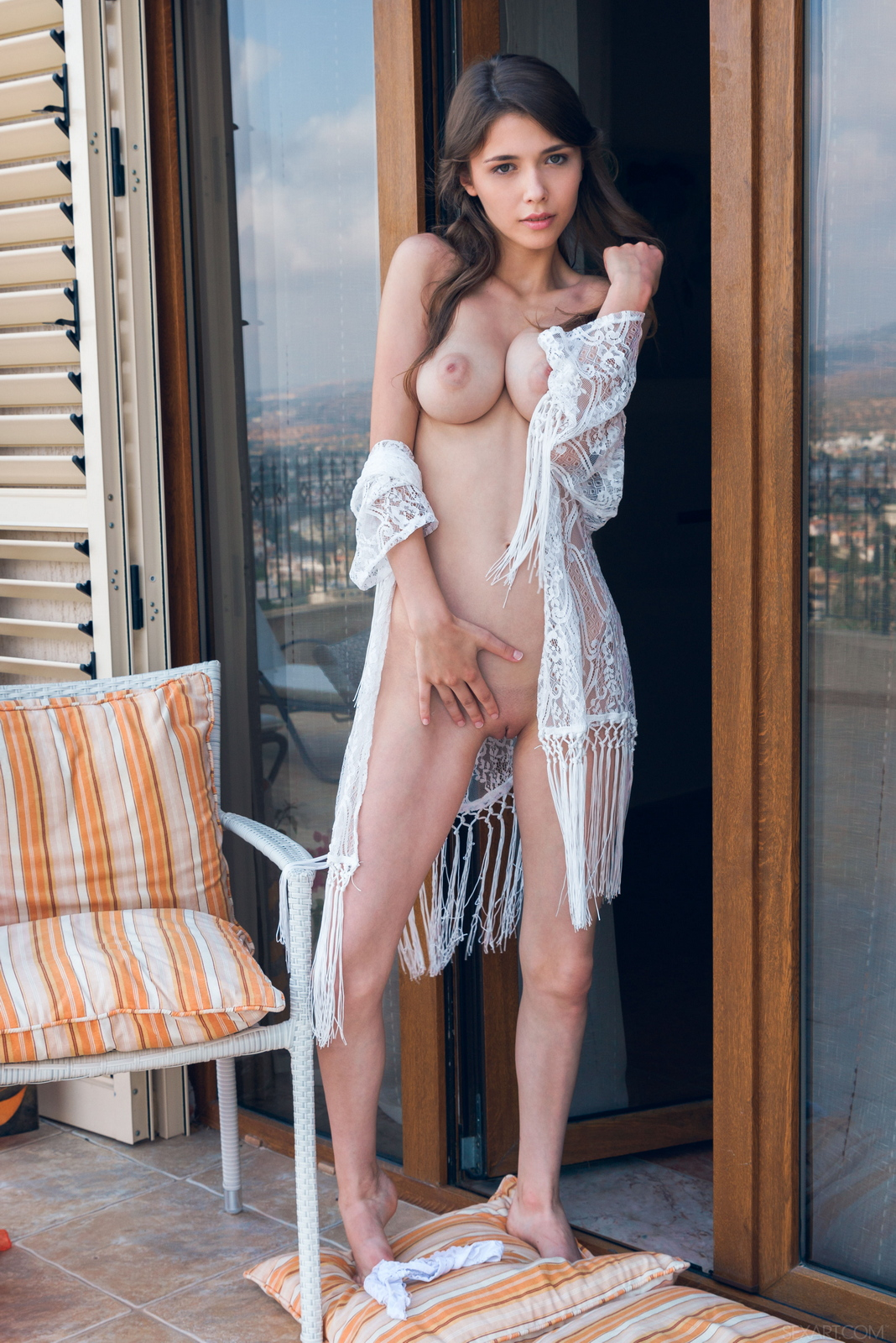 mila-azul-balcony-naked-boobs-slim-sexart-12