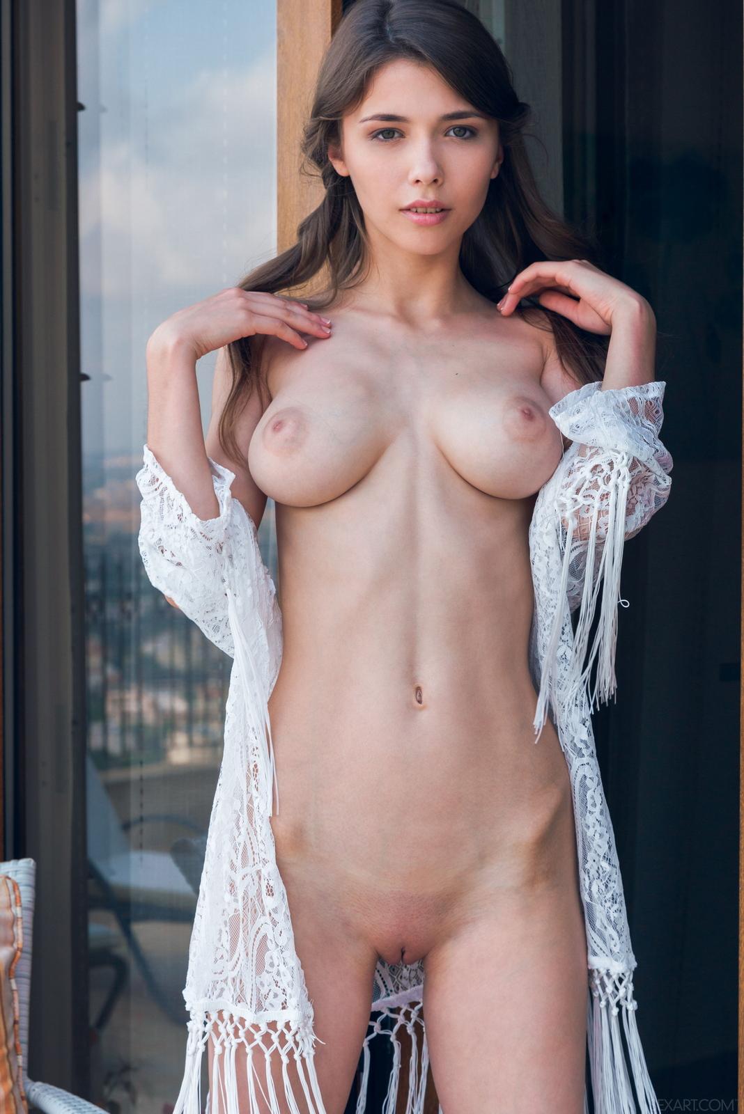 mila-azul-balcony-naked-boobs-slim-sexart-14